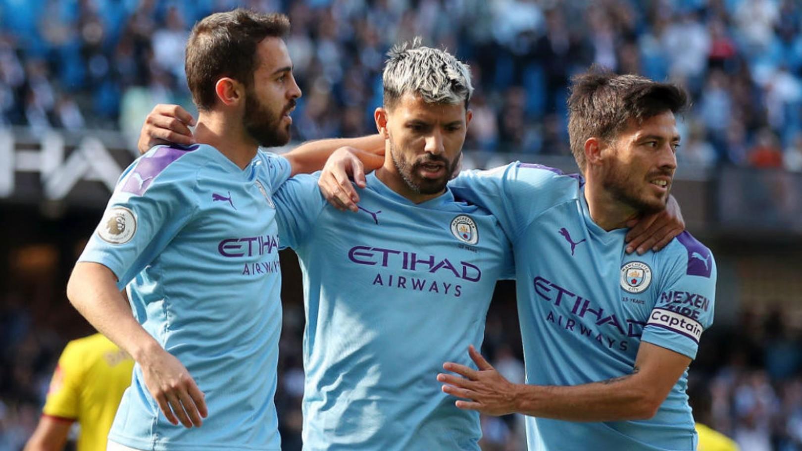 CENTRE OF ATTENTION: Bernardo and David Silva salute Sergio Aguero after his 100th goal at the Etihad