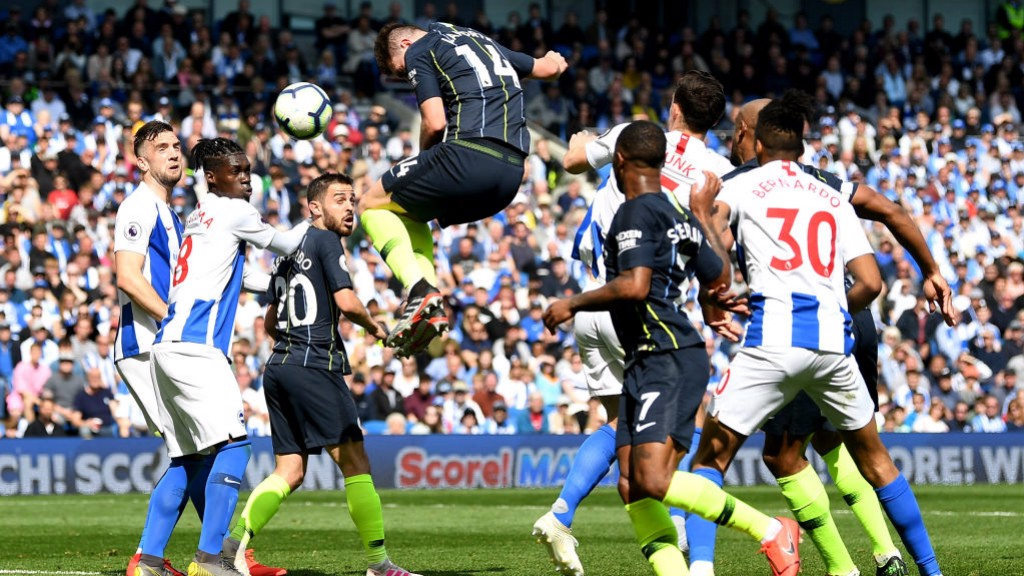 HIGH JUMP : Aymeric Laporte rises highest to give City a 37th minute lead.
