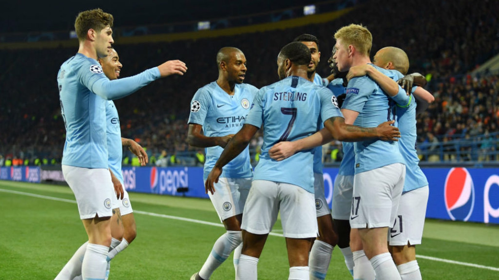 CELEBRATION TIME: The City players salute David Silva after the skipper's brilliant strike