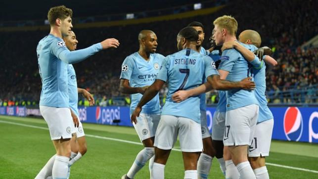 CELEBRATION TIME : The City players salute David Silva after the skipper's brilliant strike
