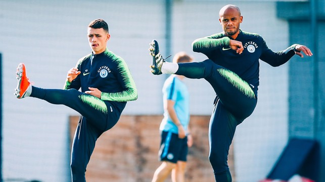 YOUTH AND EXPERIENCE : Phil Foden and skipper Vincent Kompany warm up