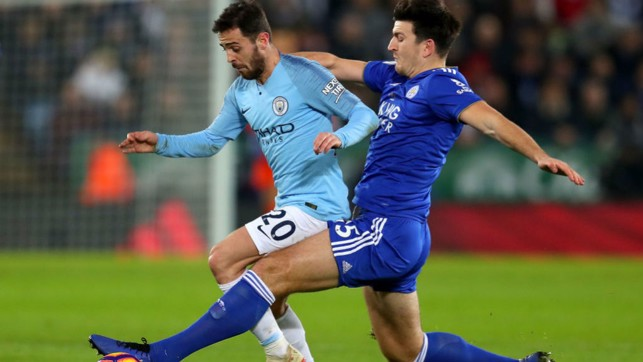 SHADOW PLAY : Bernardo Silva looks to shake off Harry Maguire