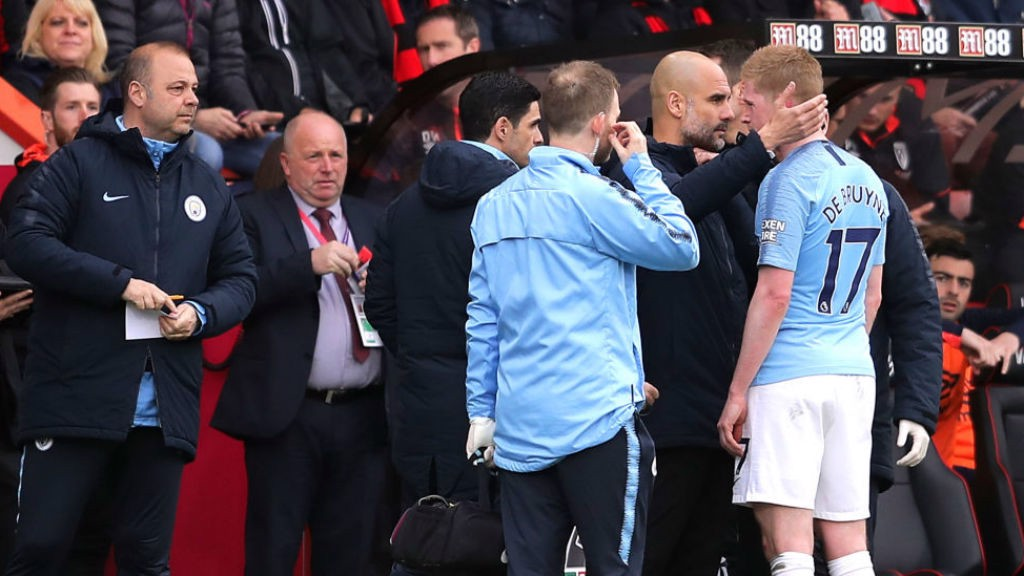 BLOW: The boss consoles Kevin De Bruyne after he was forced off