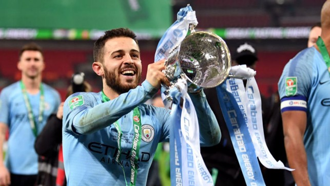 SILVA DREAM MACHINE : Bernardo lifts the Carabao Cup aloft again after our dramatic penalty shoot-out win over Chelsea last month