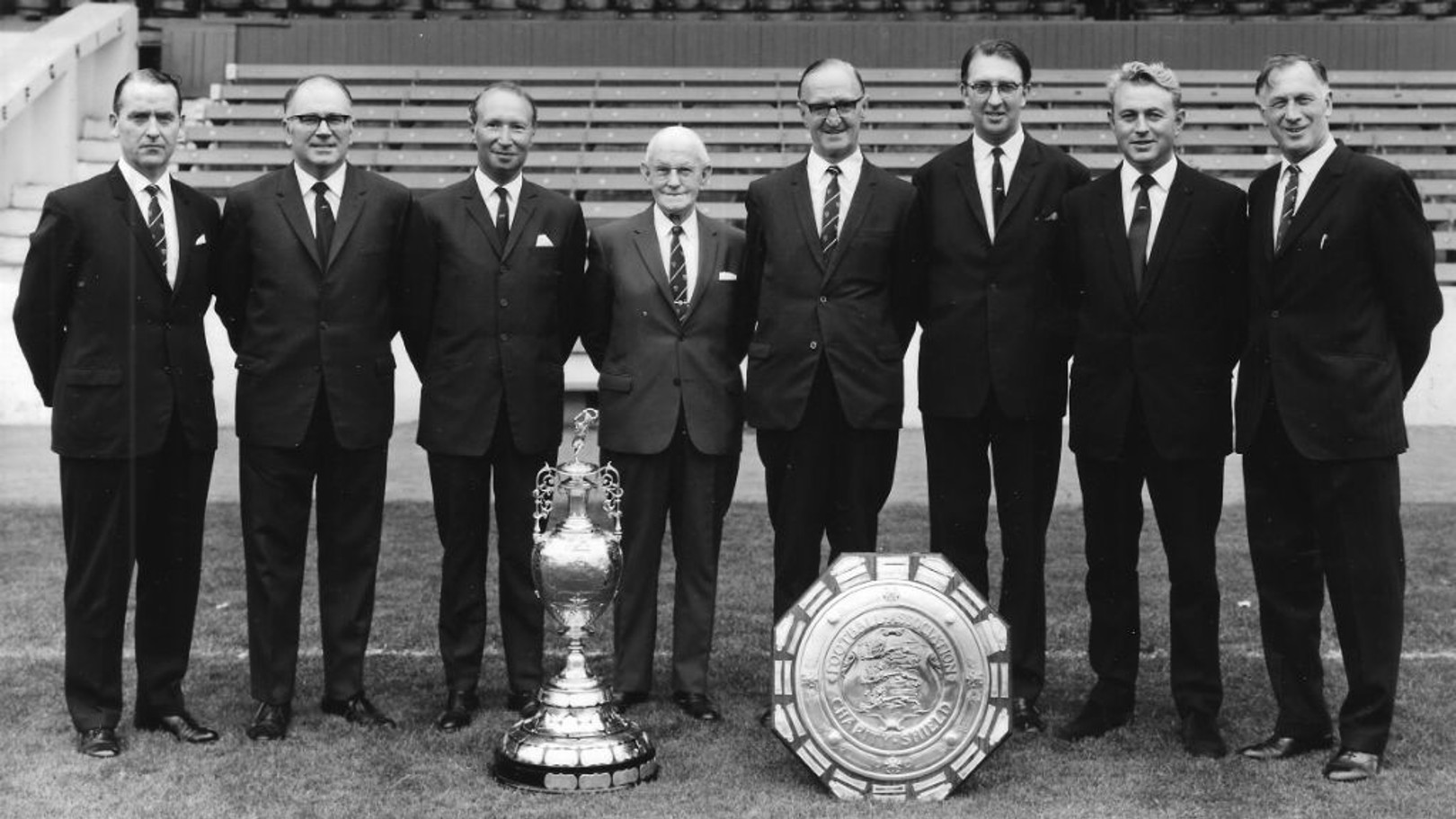 TRUE BLUE: Eric Alexander is pictured second right next to Joe Mercer and City's directors following our 1968 league title and Charity Shield triumphs