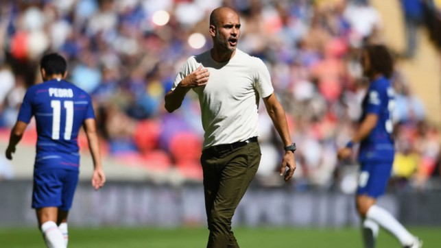 TALKING POINTS : Manager Pep Guardiola urges City on during Sunday's Community Shield clash with Chelsea
