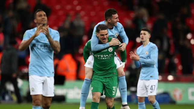 UP FOR THE CUP : Aymeric and Ederson celebrate after our 2018 Carabao Cup final triumph over Arsenal