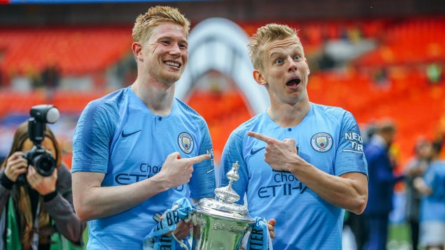 IDENTICAL : Oleksandr Zinchenko and KDB strike a pose