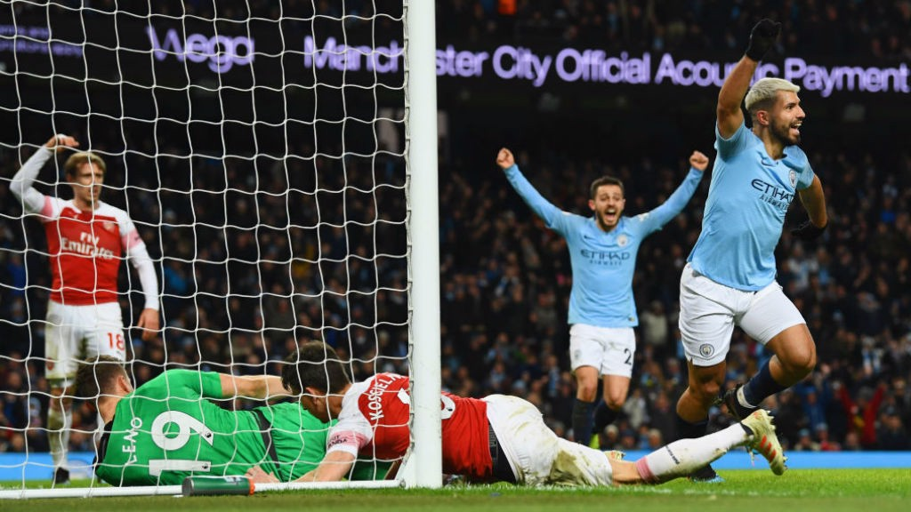 OUT OF SIGHT : Aguero scrambles the ball over the line to secure hat-trick.