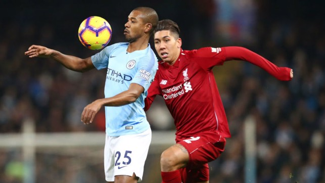 BRAZILIAN BLEND : Fernandinho shields the ball from Brazil team-mate Roberto Firmino