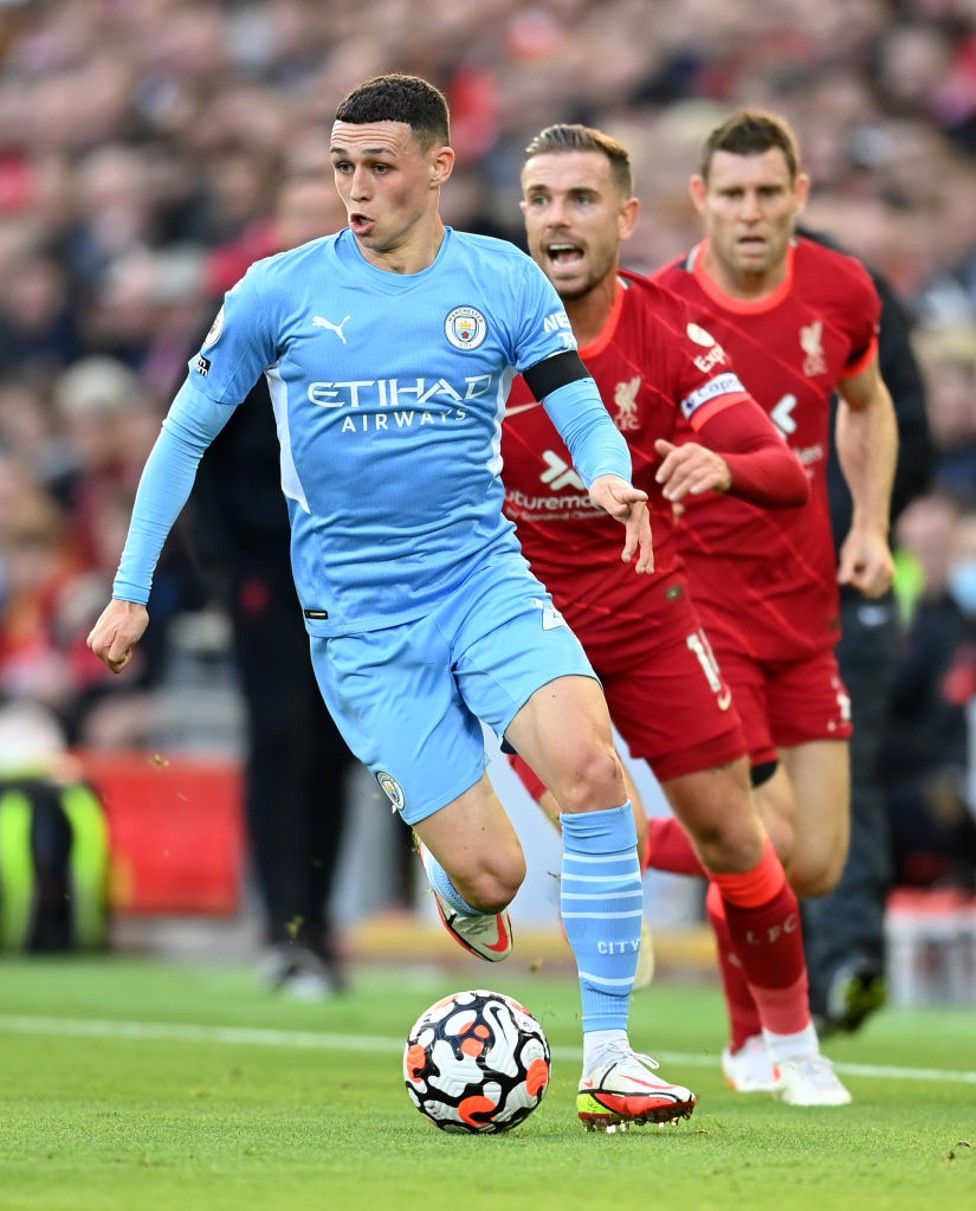 PHIL-ING IT : Foden bursts away from Henderson.
