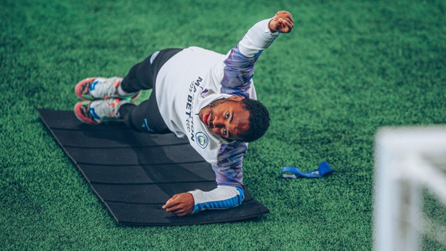 AT FULL STRETCH: Raheem Sterling goes through an exercise routine