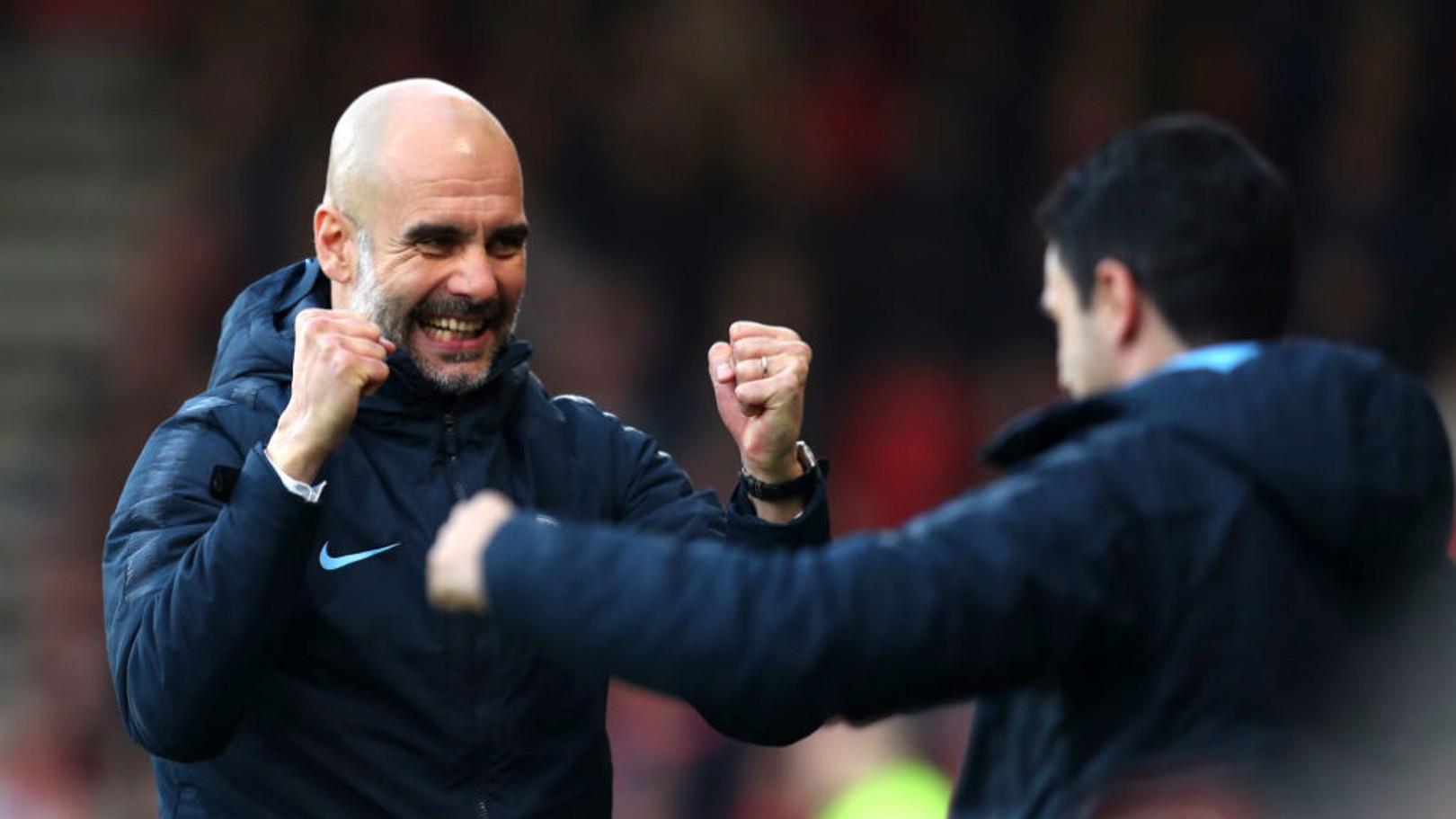 SMILES BETTER: Pep Guardiola celebrates our opener with Mikel Arteta