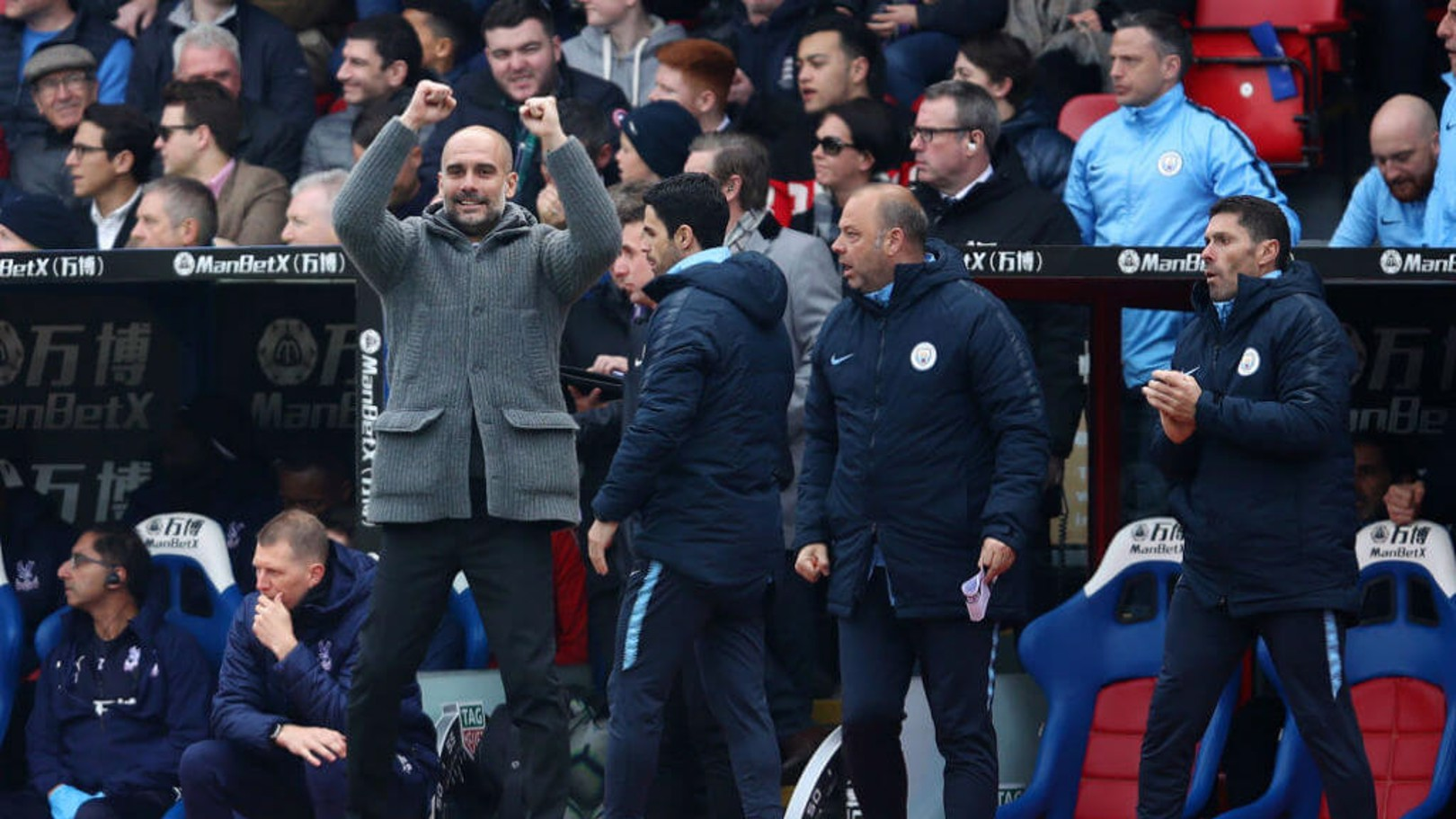 GLEEFUL GUARDIOLA: Pep celebrates City's opener.
