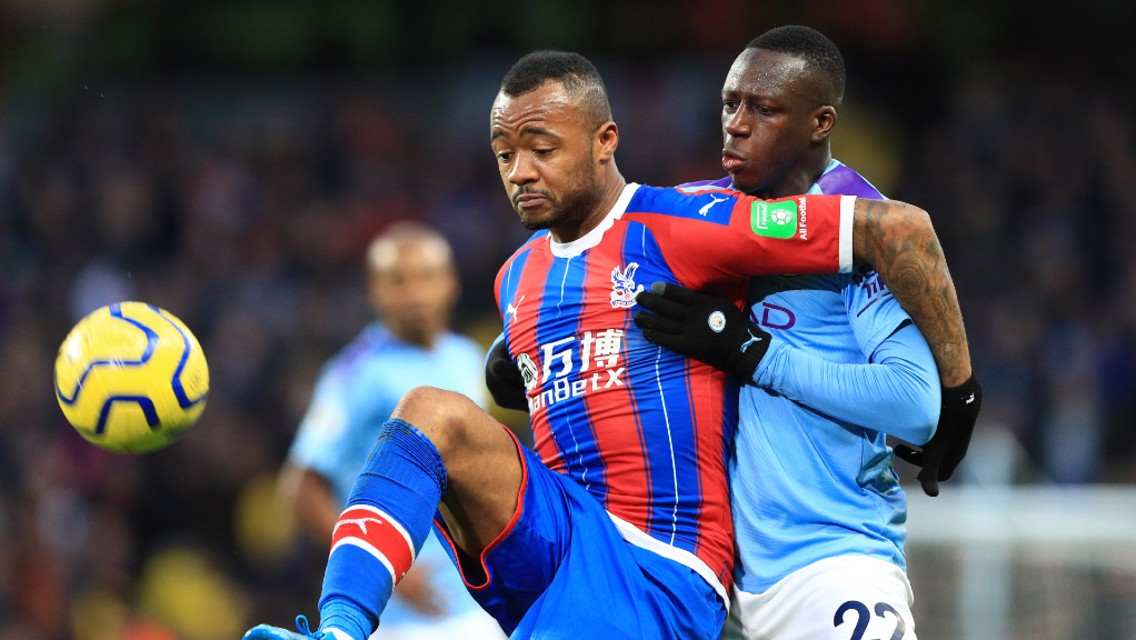 BATTLE: Benjamin Mendy challenges Jordan Ayew for possession