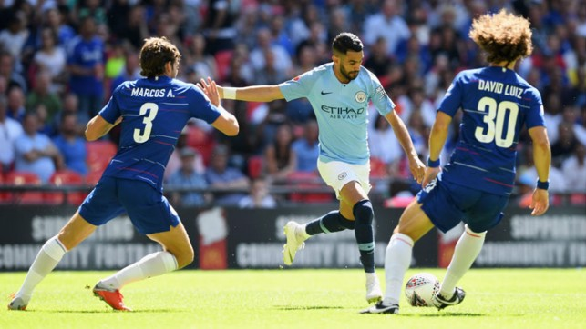 ACTION MAN : Riyad Mahrez looks to fire in a shot on the Chelsea goal