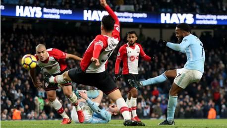 FABULOUS FINISH: Raheem Sterling curls home his stunning winner against Southampton