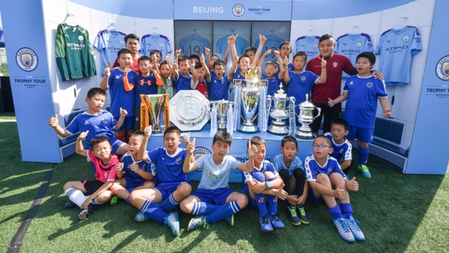 TROPHY LADEN : A photo to treasure for a group of Beijing youngsters.