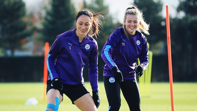 ON THE MOVE : Megan Campbell and Lauren Hemp limber up ahead of the West Ham clash