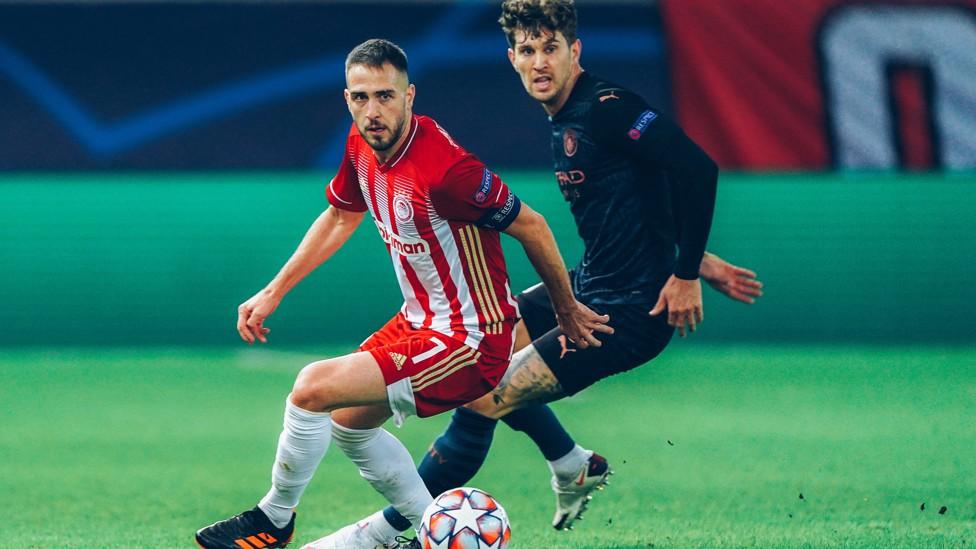 DUA SEKAWAN: Stones menjadi starter bersama Ruben Dias untuk pertama kalinya saat City mengalahkan Olympiakos 1-0 pada November 2020.