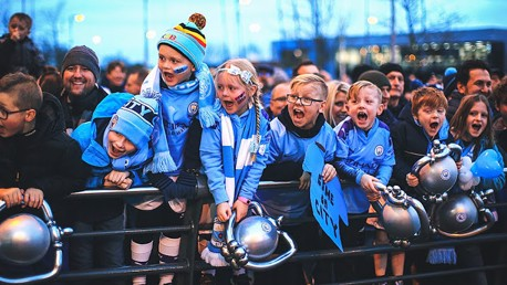 YOUNG AT ART: These excited City fans get ready to greet their heroes