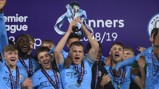 GLORY BOYS: Skipper Rowan McDonald lifts the Premier League U18 Cup aloft alongside his joyous City team-mates