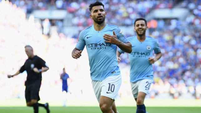 TWO GOOD : Sergio Aguero celebrates after doubling his personal tally and City's lead