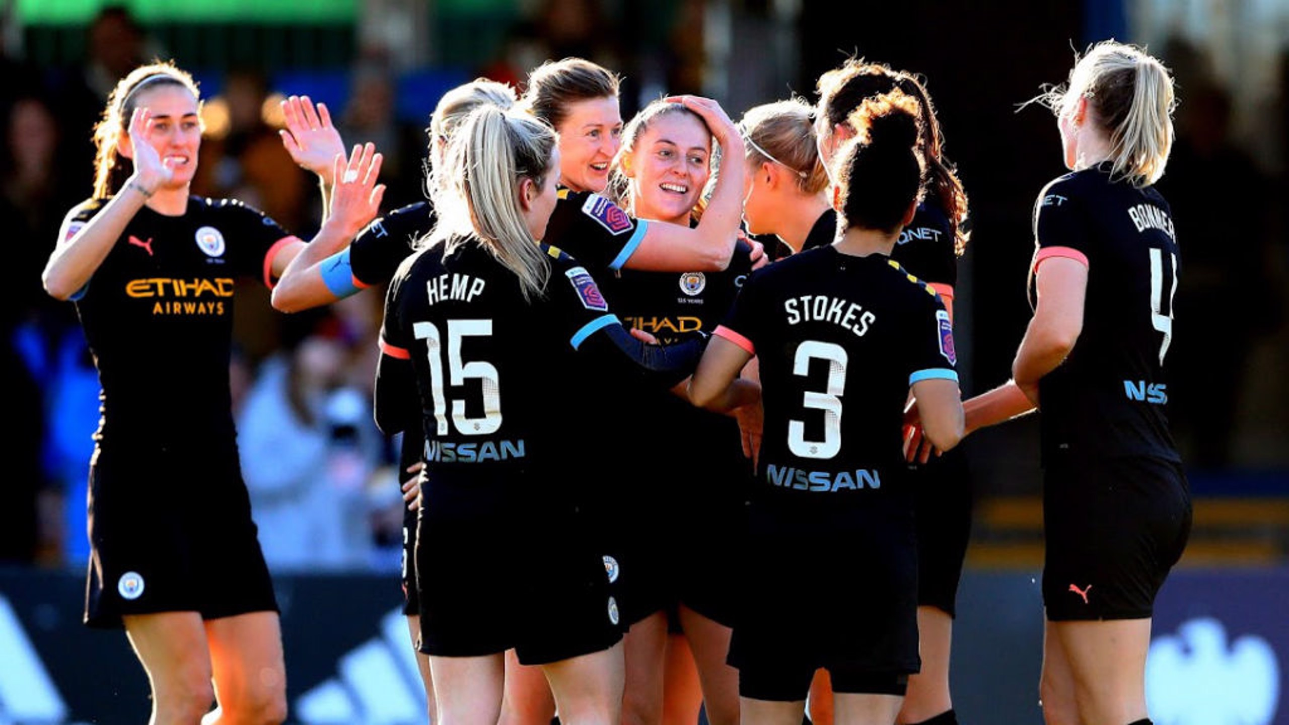 ALL SMILES: Keira Walsh celebrates with her City team mates after doubling our lead