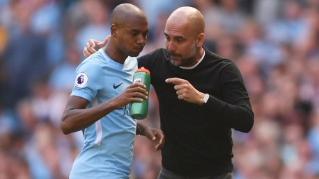 IN CONVERSATION: Pep Guardiola and Fernandinho.