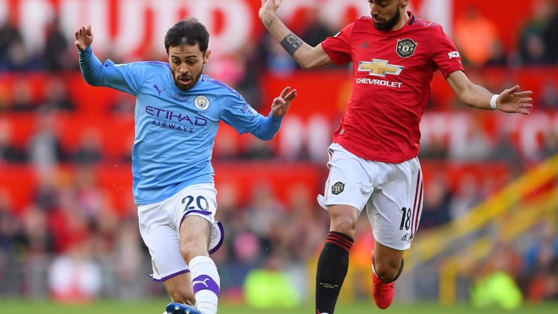 Bernardo Silva takes on Bruno Fernandes.