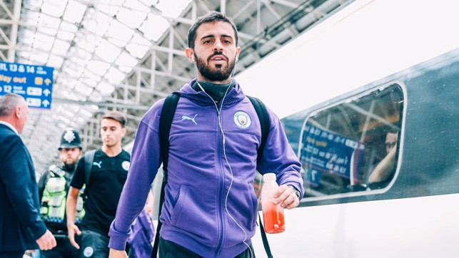 PURPLE REIGN : Bernardo Silva is a study in focus as the City squad board the train to Euston
