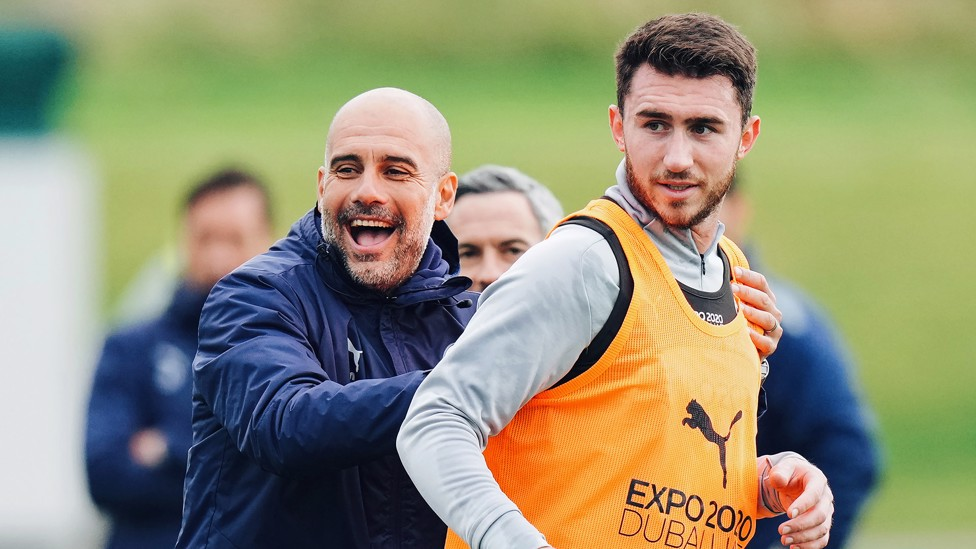 TOUCH TIGHT : The boss and Aymeric Laporte pictured during today's session