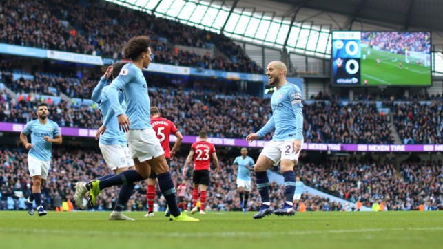 ALL SMILES : Leroy Sane and David Silva start the celebrations after City's opener