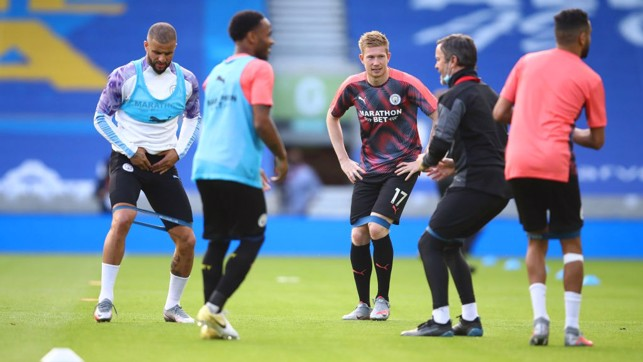 BRIGHTON EARLY: The lads limber up before the match