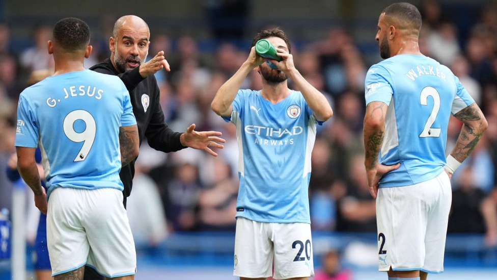 PEP TALK : The boss provides some instructions midway through the first-half.