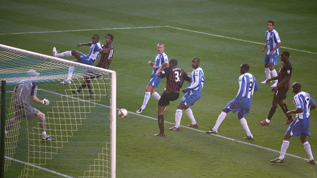 TAP IN : Kompany squeezes the ball in for his first City goal against Wigan in 2008