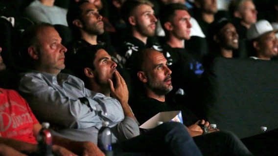 PREMIERE: Pep Guardiola watches on intently...