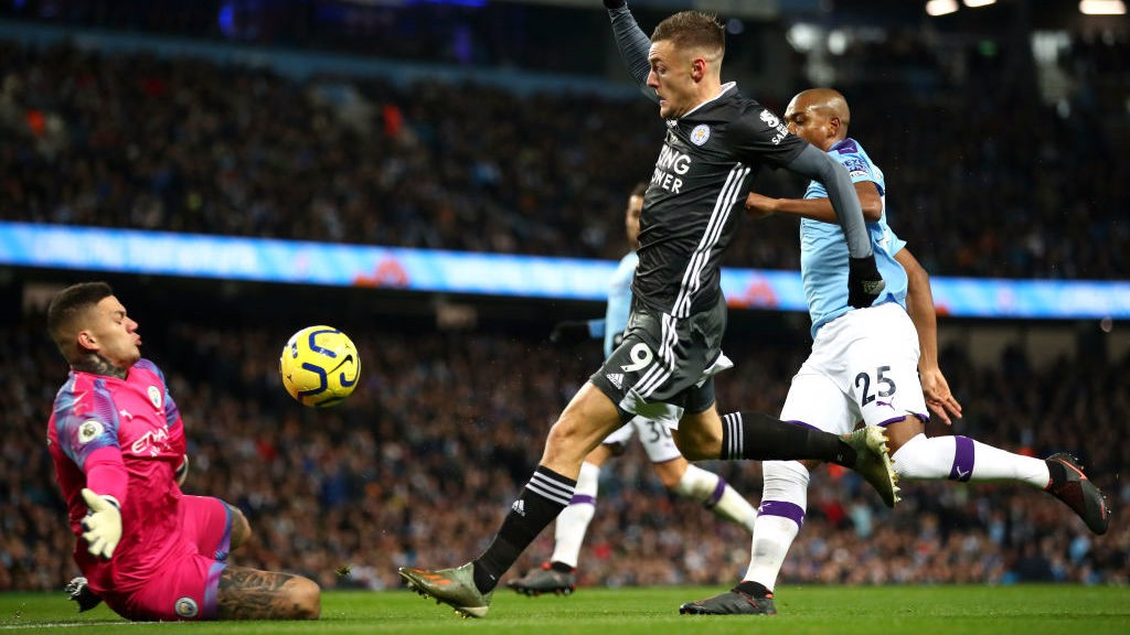 OPENER: Vardy clips the ball over Ederson to give Leicester the lead.