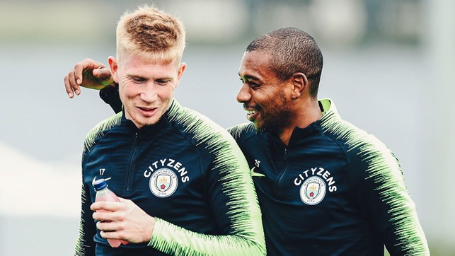 TWO'S COMPANY : Something has tickled Fernandinho and Kevin De Bruyne