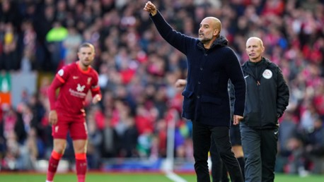 PEP TALK: The boss passes on instructions from the touchline.