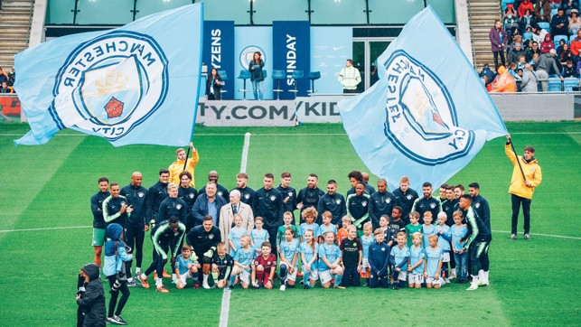 CITYZENS : A group of lucky fans got the chance to join the players for a team photograph