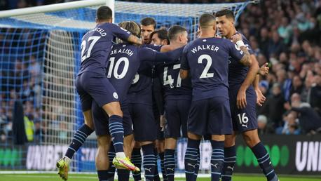 GROUP HUG: The players gather to celebrate Gundogan's goal.