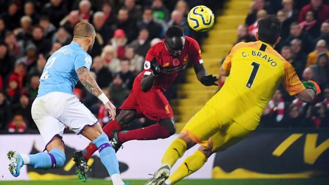 THREE UP : Sadio Mane nods home to put Liverpool three goals to the good.