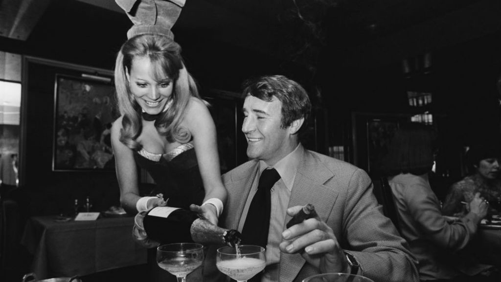 LARGER THAN LIFE: Big Mal relaxes with a trademark cigar, champagne and the company of a Bunny Girl!