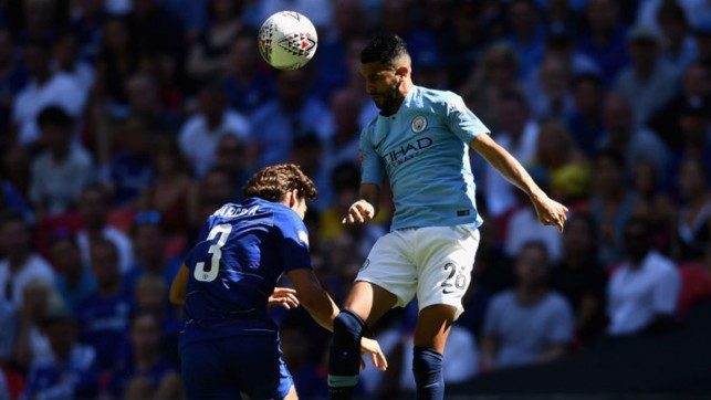 HEAD BOY : Riyad Mahrez gets an early taste of the action for City as he beats Marcos Alonso