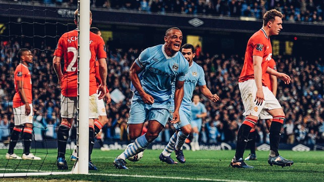 DERBY DELIGHT : Vincent Kompany's face says it all as he crashed home a winner that sent us top of the league on goal difference with two games of the 2011/12 season left to play.
