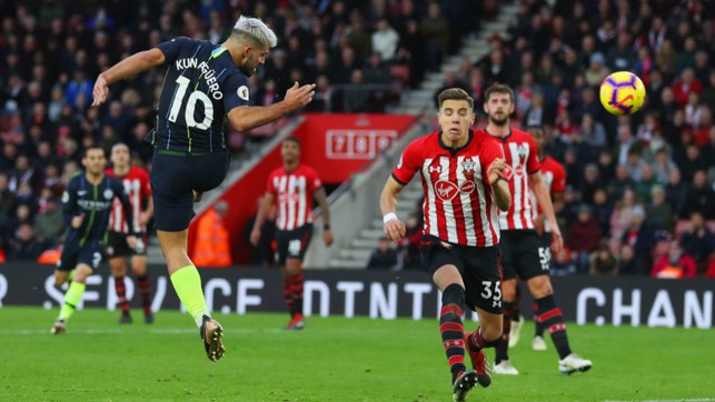 UP AND AT 'EM : Sergio Aguero leaps to head home our third goal in first half injury time