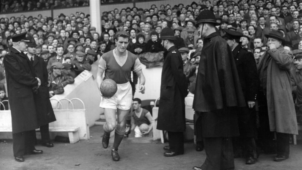 LEADING MAN: Malcolm Allison leads West Ham out in a game from 1956