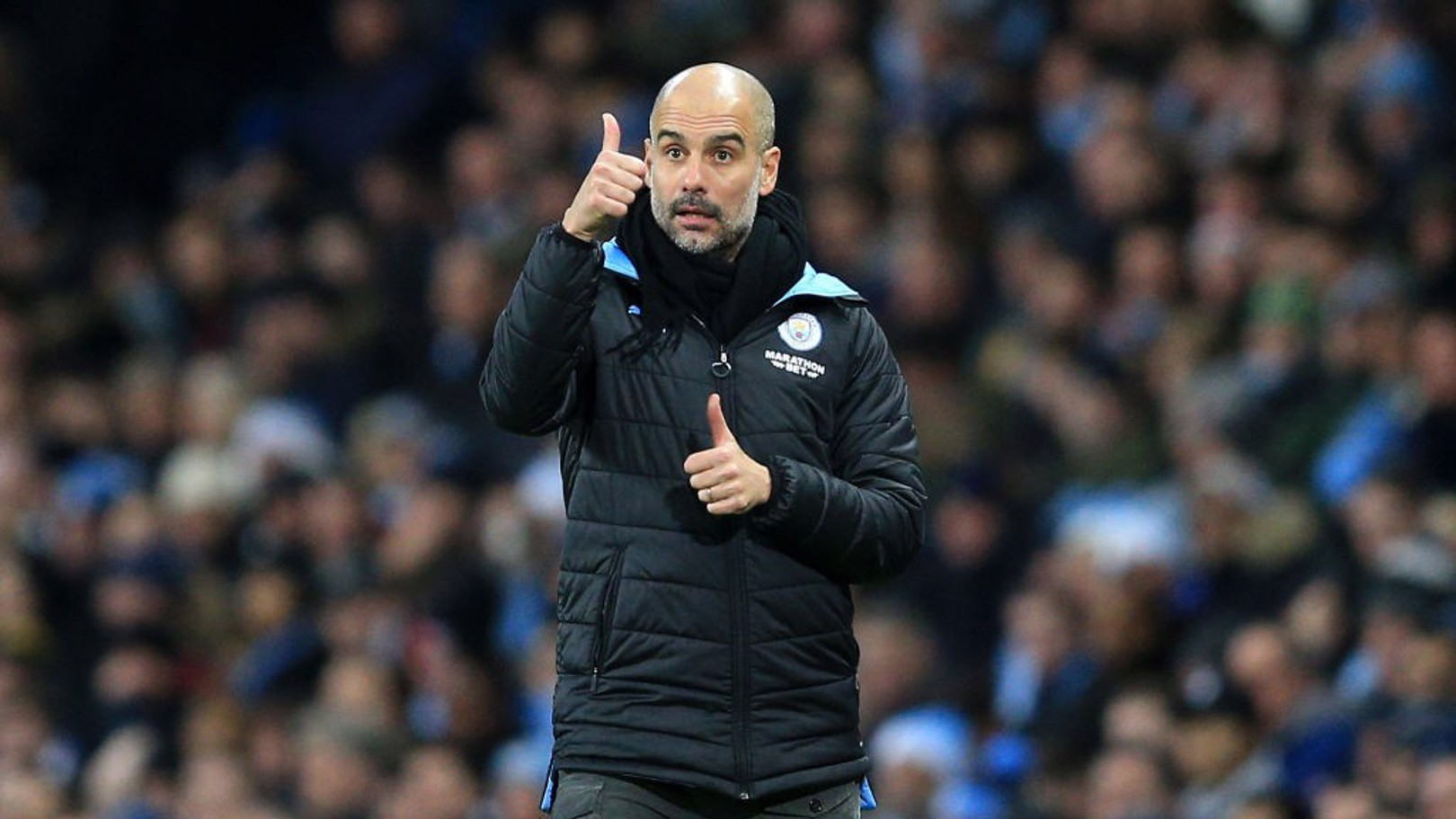 THUMBS UP: Pep Guardiola hailed the City fans after the 3-1 win over Leicester.
