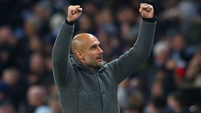 GUARDIOLA : The boss celebrates City's opening goal.